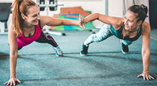Image of two women working out