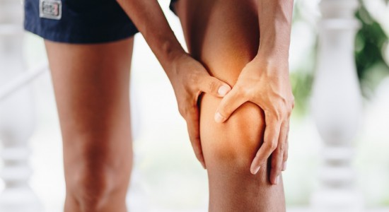 Picture of woman grabbing knee