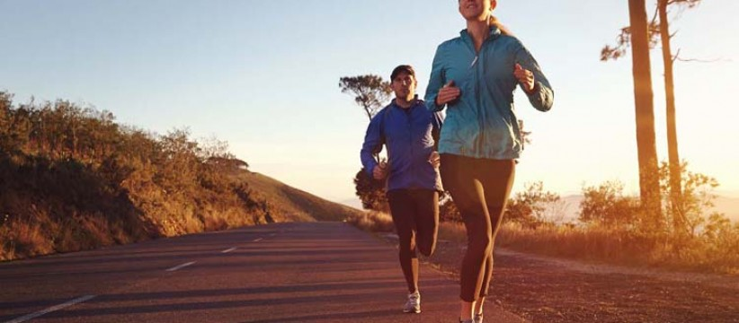 Two people running outdoors