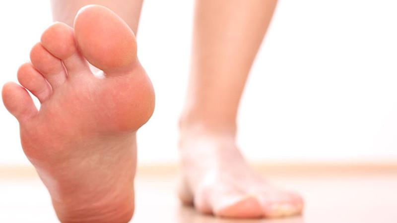image of feet on beach