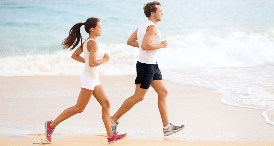 Image of couple running on beach