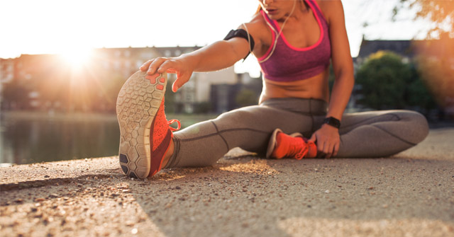 Image of a female runner stretching