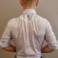 Image of a man squeezing shoulder blades together