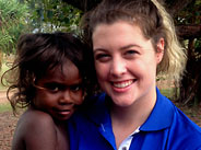 Image of a volunteer with child at Palm Island